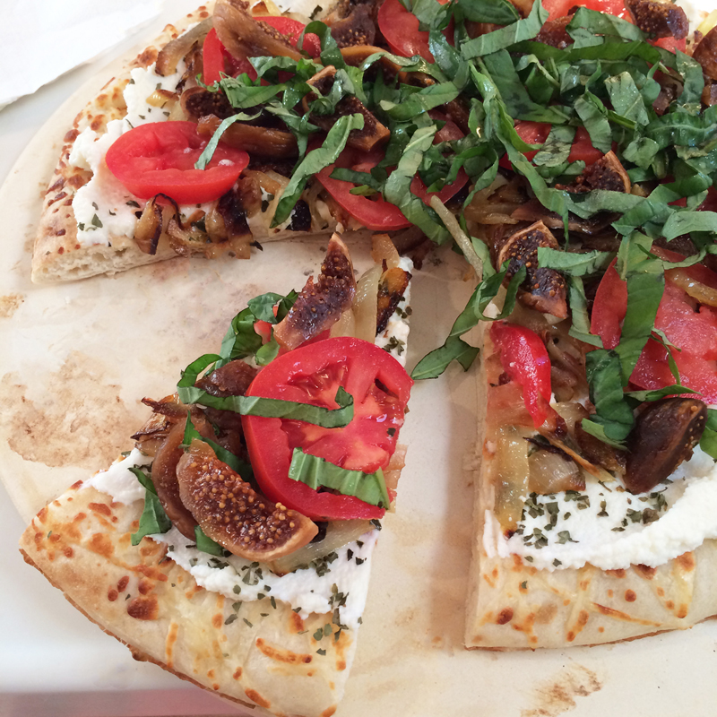 Image about Savory pizza sliced with figs | Bazilian